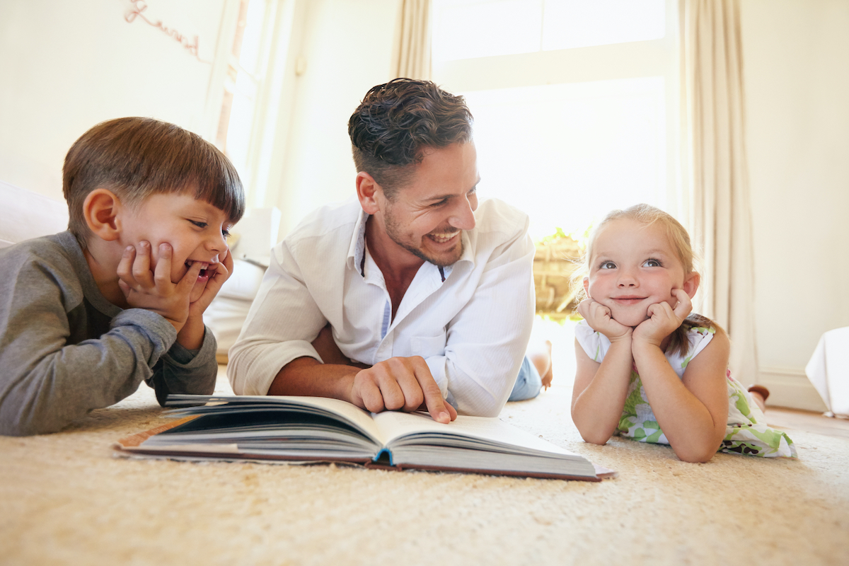 father and kids reading - bibliotherapy