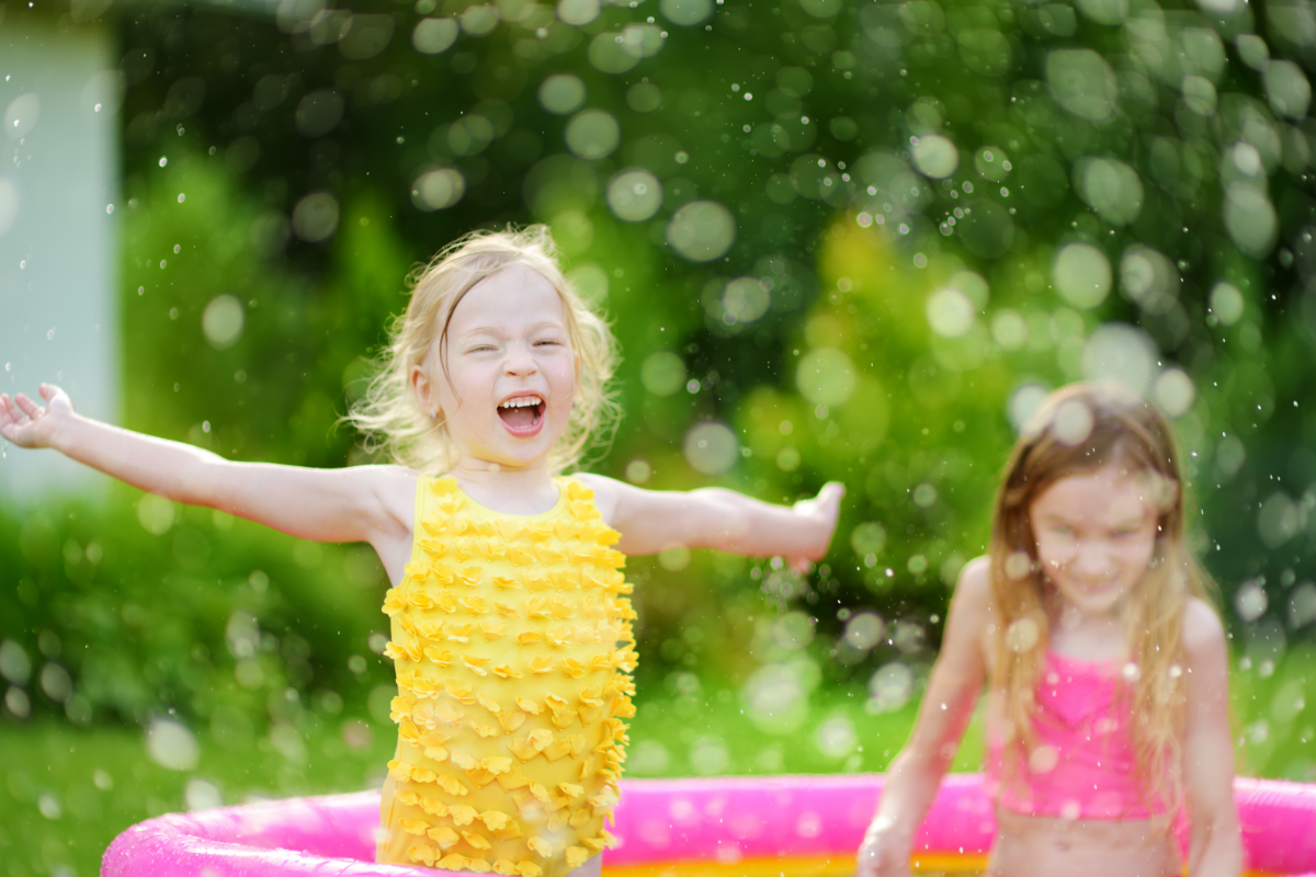 girl playing in the pool easy DIY summer activities for kids