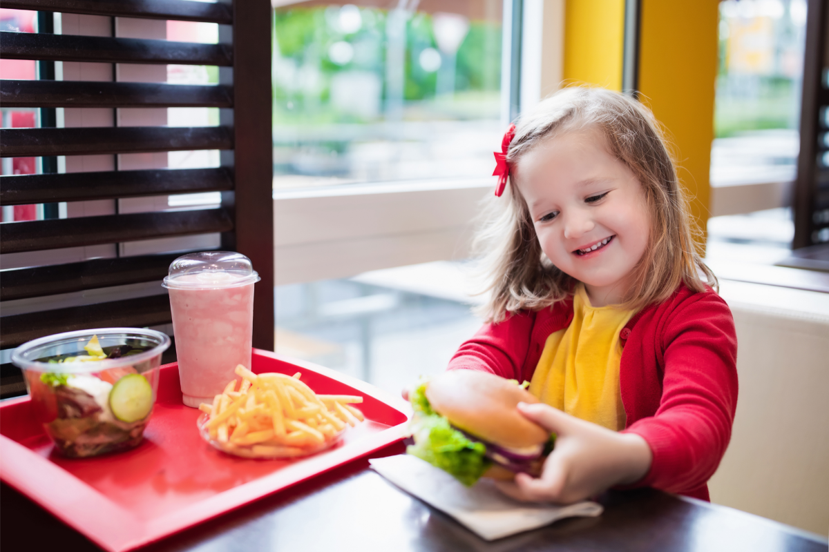 girl eating healthy fast food for kids