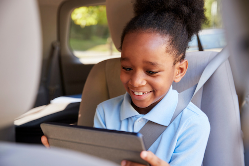 what are the best apps for kids? Boy using ipad in car