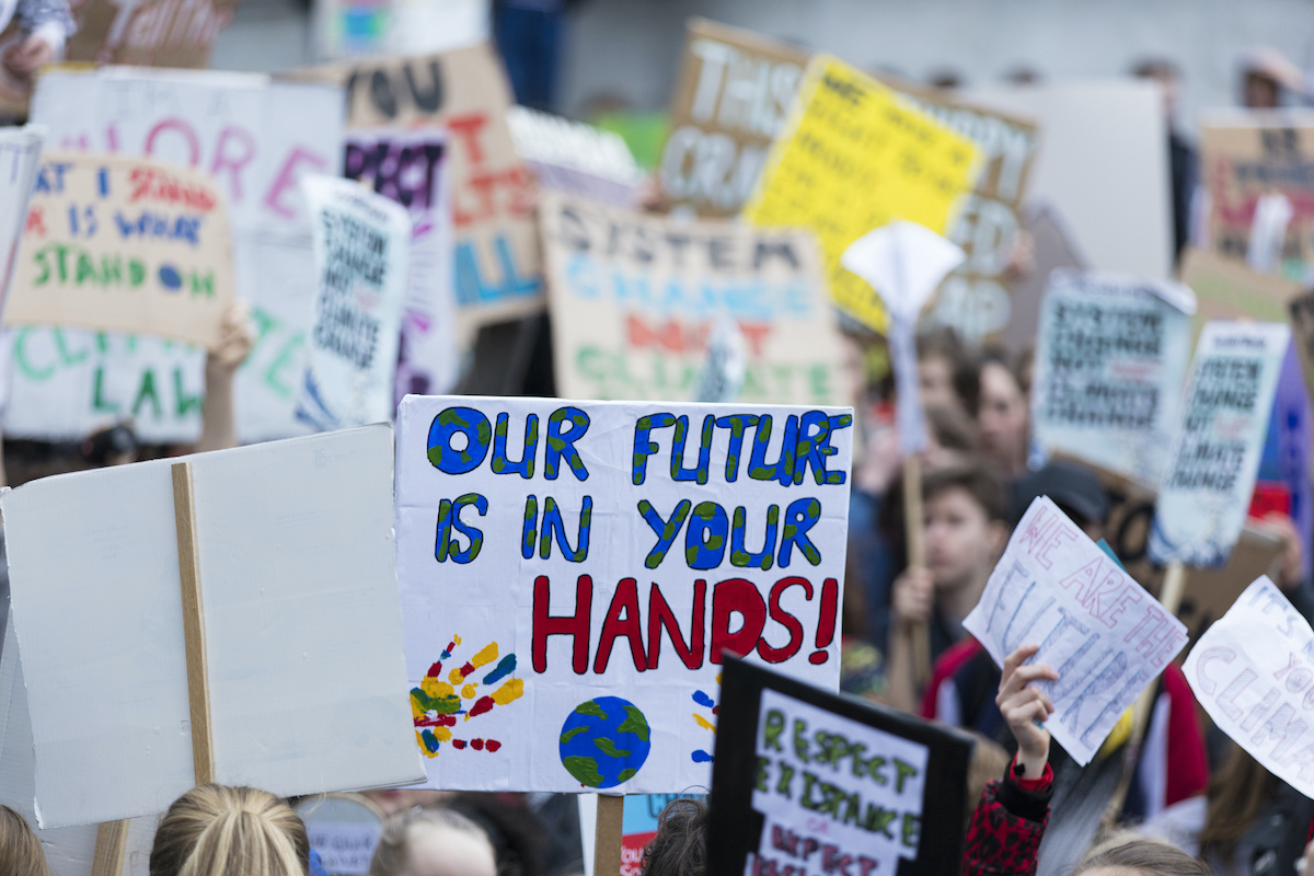 How do you talk to your kids about politics? activists and signs