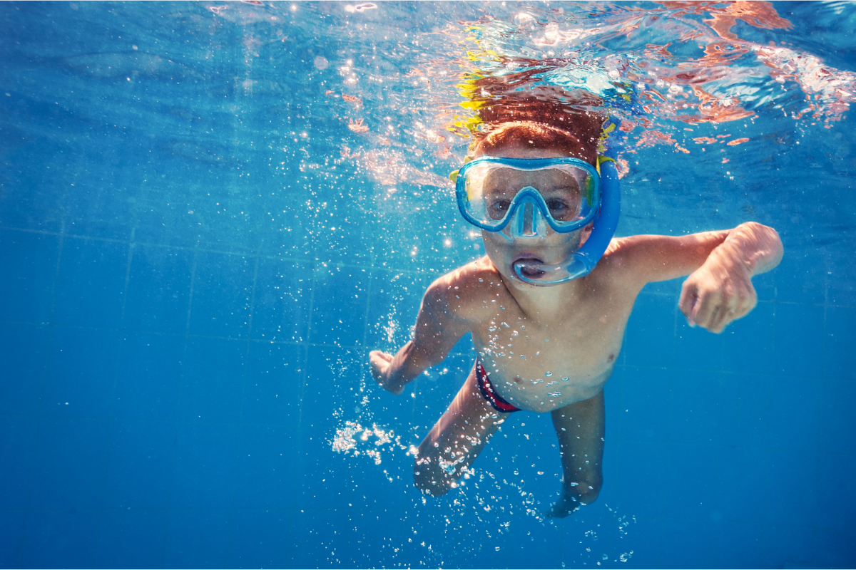kids water safety in a pool snorkeling