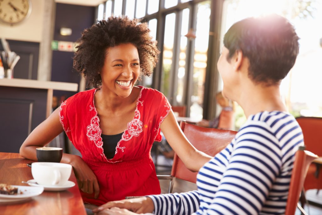 instead of phubbing, make human connections. 2 women at a coffee shop